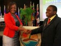 2013 Tourism Youth Congress willing Neila Jones congratulates her compatriot, Rol-J Williamson winning on keeping the title in Nevis