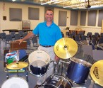Oneida City School 7/8 Band Director Nick Anderalli with instruments and music supplies collected by Oneida City School District teachers and donated to the St. Kitts and Nevis Music Project.