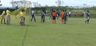 St. Thomas' player in green guilty of allowing ball to strike his hand within the box