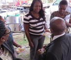 Employees speaking with St. Kitts and Nevis' Prime Minister the Rt. Hon. Dr. Denzil L. Douglas following the ceremony at the C.A. Paul Southwell Industrial Estate to launch the New National Minimum Wage and the Long Service Gratuity Scheme .