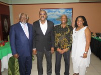 ARICOM Chairman, Prime Minister of Antigua and Barbuda, Hon. Gaston Browne (2nd left) shares photo with (from left) Dr. Julius Garvey, son of Marcus Mosiah Garvey, National Hero of Jamaica; Dr. Douglas Slater, Assistant Secretary General, Human and Social Development, CARICOM Secretariat; and Dr. Hillary Browne, Programme Manager Culture and Community Development, CARICOM Secretariat, at the 2nd Regional Conference on Reparations, Antigua and Barbuda, Oct. 12-14, 2014.