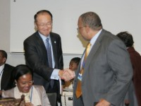 Finance and Planning Minister, Dr. the Hon. Peter Phillips, is greeted by World Bank President, Jim Young King, on his arrival at the headquarters of the World Bank on Sunday, October 12, for a meeting with Caribbean Ministers of Finance and Governors of Central Banks (Media Credit: Derrick Scott)