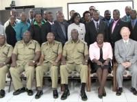 Ambassador Browne, Senior Officers, facilitators and class participants pose for group photo