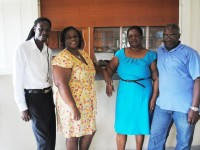 The perfect team: PEP Field Officer in Nevis, Mr Shaun Delashley (left), with PEP worker at Judith Catering Services canteen at Brown Hill Communications, Ms Elise Watts, and proprietors of Judith Catering Services, Mrs Judith Dore and Mr Wrenford Dore.