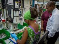 Prime Minister Dr. Hon. Denzil Douglas visiting manufacturing plant, 2014. f