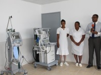 Deputy Premier of Nevis and Minister of Health Hon. Mark Brantley with Nurse Manager Jessica Scarborough (middle) and Critical Care Nurse Sylvannie Andre at the commissioning ceremony of a new ventilator machine (left) and an anaesthesia machine at the Alexandra Hospital on November 26, 2014