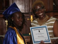 Charlestown Secondary School's Caribbean Certificate of Secondary Level Competence (CCSLC) Valedictorian Ochanta Parris receives her Certificate of Graduation from Mrs. Marva Roberts