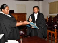 Ms. Yvonne Bussue (right) taking the Oath administered by the Acting Registrar, Mrs. Tashna Powell-Williams.