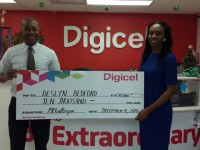 Deslyn Bedford of Molineux receives her $10,000 presentational & actual cheque from Digicel Finance Manager, Sheldon Mitchell