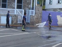 Fire officers cleaning Charlestown