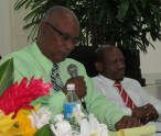 St. Kitts and Nevis' Prime Minister the Rt. Hon. Dr. Denzil L. Douglas (right) listens at the Political Leader of the Nevis Reformation Party (NRP) speaks.