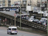 French police stand on the Paris ring road near the scene of a hostage taking at a kosher supermarket in eastern Paris