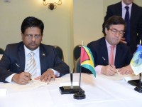 Finance Minister Dr Ashni Singh and Inter-American Development Bank President, Luis Albert Moreno sign the US$32.16M loan