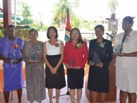 First Lady Deolatchmee Ramotar with women who were honoured for their contributions to Guyana