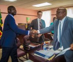 Kevin Silston, IMF Advisor greets Prime Minster Harris while Serge Dupont, IMF Executive Director looks on