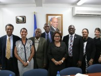 : At Centre, Hon. Minister Dr Guillaume with Mr Dereck Springer, Dr Deas HIV/AIDS coordinator, and Ms Sarah Romorini, PSI consultant on the far right. Ms Anick Supplice Dupuy, Director PSI, Haiti with Drs Reynold Grand-Pierre; Dr Dellonay Brunel; and Dr Jules Grand Pierre on the left.