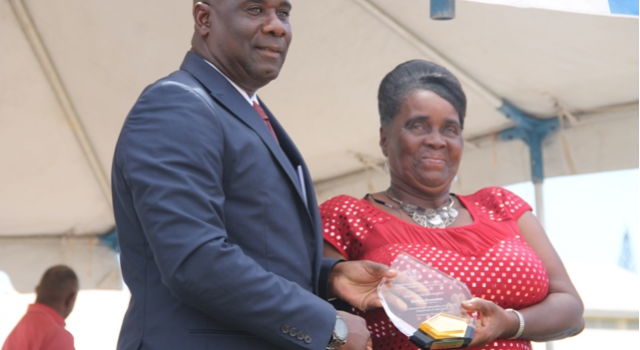 Minister of Agriculture on Nevis Hon. Alexis Jeffers presents a plaque to Patron of the Department of Agriculture's 21st annual Open Day Roslyn Cranston at the opening ceremony at the Villa in Charlestown on March 26, 2015