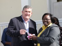 Junior Minister responsible for Social Development Hon. Hazel Brandy-Williams receiving the keys to a new mini bus from Insurance Manager for AMS Trustees Derrick Lloyd for use in the Sports Health And Wellness programme