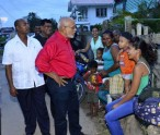 President Donald sharing a light moment with a group of residents in Rose Hall, Berbice