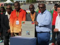 Kim Collins holds inscribed stone flanked by (L-R) First PM of St.Kitts-Nevis Sir Kennedy A Simmonds, Deputy Prime Minister Shawn K. Richards and Prime Minister Dr. Timothy Harris.