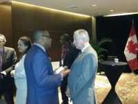 St. Kitts and Nevis Foreign Affairs Minister and Premier of Nevis Hon. Mark Brantley (center left) with Canadian Foreign Affairs Minister Rob Nicholson (center right) on April 10, 2015, at a cocktail hosted by the Canadian Official for Caribbean Community Foreign Affairs Ministers attending the Summit of the Americas in Panama