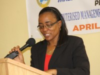 Head of the Small Enterprise Development Unit Catherine Forbes at the opening ceremony of the Caribbean Development Bank-sponsored Management Accounting Systems for MSMEs workshop on April 13, 2015 at the Department of Education's Conference Room