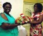Leander Cornelius --left receives flowers from Janet Meloney-Director of Community Development