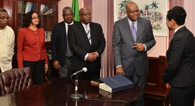 Resident Judge Her Ladyship Justice Marlene Carter (far right) congratulates Acting Governor General Seaton after administering oath in the presence of Cabinet members (left to right) Minister Ian