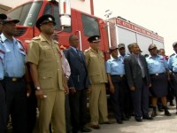 Chief Fire Officer O'Garro (center) and Permanent Secretary in the Office of the Prime Minister Osbert DeSuza (3rd from right) along with other Fire Service Officers with new tender. (Media credit: SKNIS