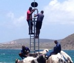 A frame for the navigational lighting being erected on top of Cow and Calf rocks in the Narrows between St. Kitts and Nevis