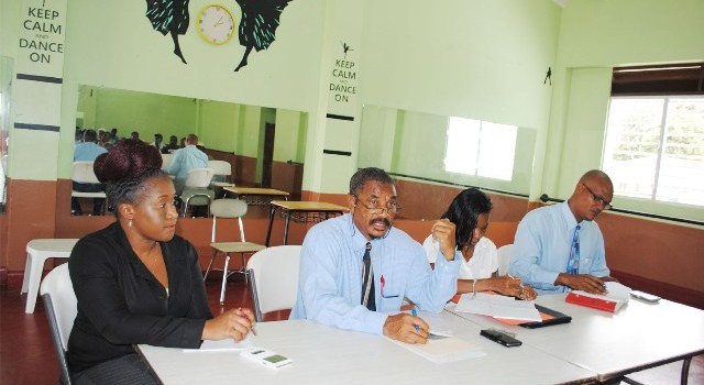 Permanent Secretary in the Prime Minister's Office, Mr Osbert DeSuza (2nd left) addressing PEP supervisors at the Victoria Road Community Centre. With him are from right, Mr Geoffrey Hanley, Mrs Janet Cable, and Ms Sahira David.