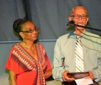 One of two surviving members of the Culturama Board of Trustees (The Board) Arthur Evelyn, receiving a plaque from Irma Johnson on behalf of the Culturama Committee 2015. She was an Ex Officio member, who served the Board as Secretary. Evelyn, is being honoured for his sterling contribution to the development and preservation of culture on Nevis during the opening ceremony of Culturama 2015 at the Charlestown Waterfront on July 23, 2015