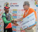 BASSETERRE, ST. KITTS AND NEVIS - JULY 04:  MARLON SAMUELS (L) of St Kitts & Nevis Patriots receives the winners cheque at the end of a match between Jamaica Tallawahs and St Kitts & Nevis Patriots as part of week 2 of the Caribbean Premier League 2015 at Warner Park on July 04, 2015 in Basseterre, St Kitts & Nevis.  (Photo by Randy Brooks/CPL)