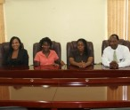L-R) Permanent Secretary in the Ministry of Health Nicole Slack-Liburd, 2015 Medical University of the Americas /Nevis Island Administration Health Science Scholarship awardees Clayticia Daniel and Pearl Bergan and Assistant Secretary in the Premiers Ministry Kevin Barrett at a press briefing at the Ministry of Finance conference room on July 6, 2015