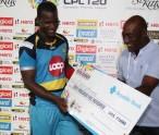 Sir Viv Richards presents Darren Sammy with the winners cheque