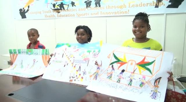 Winners of the Department of Youth and Sports, Youth in the Arts Competition Primary School category (l-r) Omar Wilkin of the Elizabeth Pemberton Primary School, Kaylan Williams and Micara Scarborough of the Charlestown Primary School  during the prize giving ceremony at the Department's conference room in Charlestown on July 28, 2015