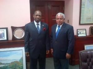 Nevis' Prime Minister the Rt. Hon. Dr. Denzil L. Douglas (left) and Cuba's Chargé d'affaires , His Excellency Hugo Ruiz Cabrera (right).