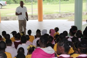 Emergency Operations Specialist of the Caribbean Disaster Emergency Management Agency (CDEMA) based in Barbados Retired Brigadier General Earl Arthurs, tells students of the Elizabeth Pemberton Primary School on Nevis the importance of taking instructions during a disaster on May 27, 2013