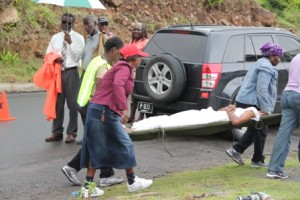 A victim is taken away from the scene by members of the Community Disaster Response Team during a multiple vehicular accident simulation exercise at River Path in Gingerland on May 27, 2013