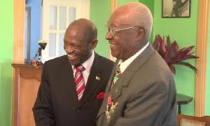 PM Douglas and Browne MBE share a joke