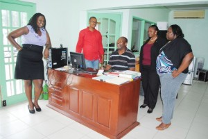 Mr Gaston Barry (centre), with PEP officials, from left, Ms Kerlyn Jones (PEP Coordinator in Nevis), Mr Geoffrey Hanley (PEP Project Manger), Mrs Celia Christopher (PEP's Training Coordinator), and Ms Telly Valerie Onu (PEP's Consultant).