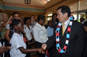 President of the Republic of China (Taiwan), His Excellency Dr. Ma Ying-jeou shakes the hand of a local student at the St. Kitts Marriott Resort.