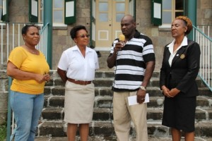 Assistant Commissioner of Police Joseph Liburd expresses appreciation after accepting a donation presented by the Nevis Renal Society's Vice President Sherolyn Pemberton, PRO Florene Williams and Treasurer Paulette Hanley to his brother Conrad Liburd.