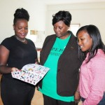PEP's Training Co-ordinator Mrs Celia Christopher (centre) and PEP official Mrs Diana Pemberton (right) admire the work of Javielle Phipps.