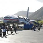 Passengers disembarking at the Robert L. Bradshaw International Airport from an American Airlines Miami flight.