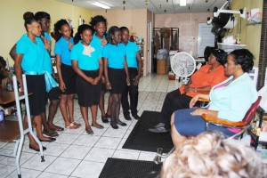 PEP Training Coordinator, Mrs Celia Christopher (sitting 2nd right) informing cosmetology trainees at Anointed Beauty Salon of the two-week break. Next to her (right) is facilitator, Ms Toovia Levine.