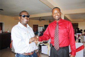 Chairperson of the Haynes Smith Youth Club, Mr Antonio Maynard (left) thanks their host and Labour Party Candidate for West Basseterre, Mr Konris Maynard.