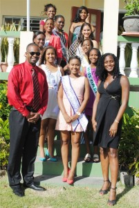 The nine contestants in the 34th edition of the Haynes Smith Miss Caribbean Talented Teen Pageant pose for a group picture after lunch with (front row from left), Mr Konris Maynard, Reigning Queen Junika Berry, and Mrs Shamara Maynard.