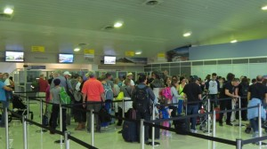 Air Canada passengers in the Arrivals Hall of the Robert L. Bradshaw International Airport o Monday.