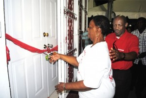 Comrade Amethyst Prentice of Upper Prickly Pear Alley preparing to cut the ribbon. Behind her is Prime Minister, the Rt Hon Dr Denzil Douglas